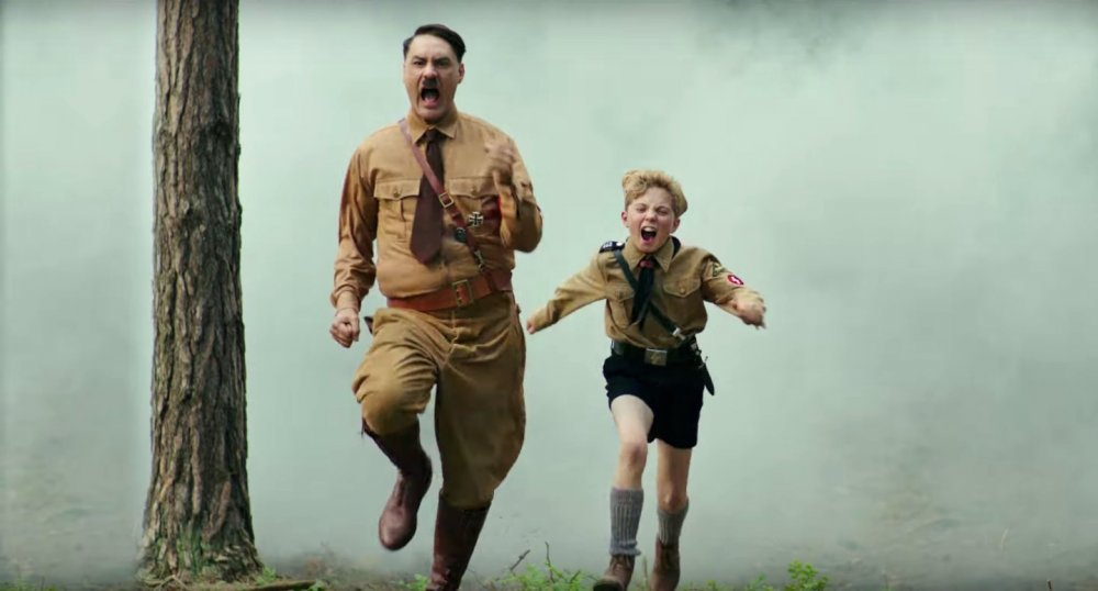 Taika Waititi as Adolf Hitler and Roman Griffin Davies as Jojo Rabbit