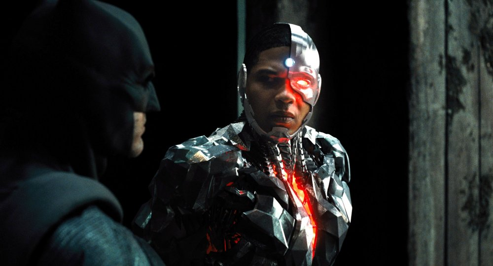 Ben Affleck as Batman and Ray Fisher as Cyborg in Justice League (2017)