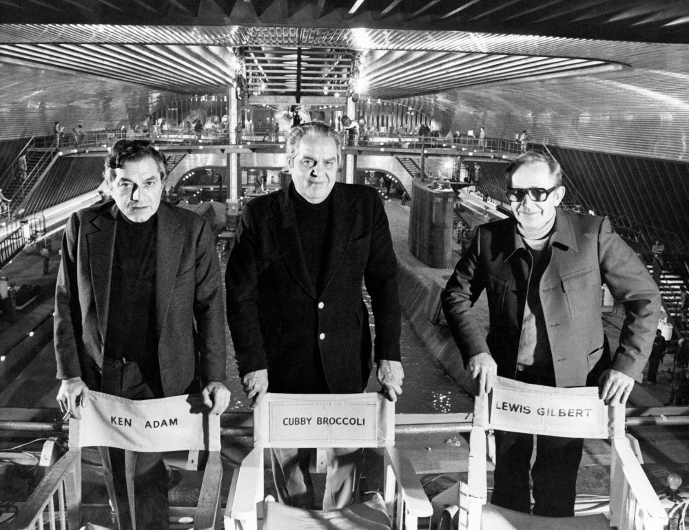 Adam (left) on set of The Spy Who Loved Me (1977) with producer Albert R. Broccoli (middle) and director Lewis Gilbert (right)