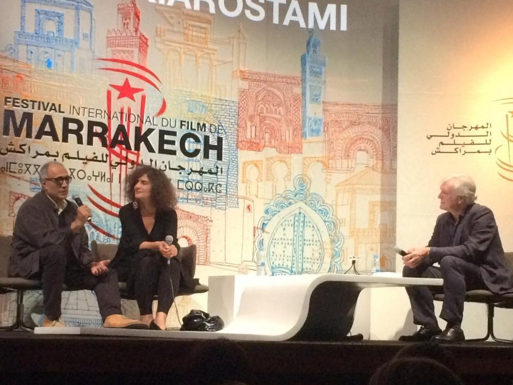 Kiarostami and Geoff Andrew on stage at the Marrakech Film Festival