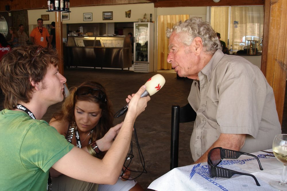 Walter Lassally interviewed a radio station in 2007, in the local taverna on the Zorba the Greek beach, where his Oscar was on display