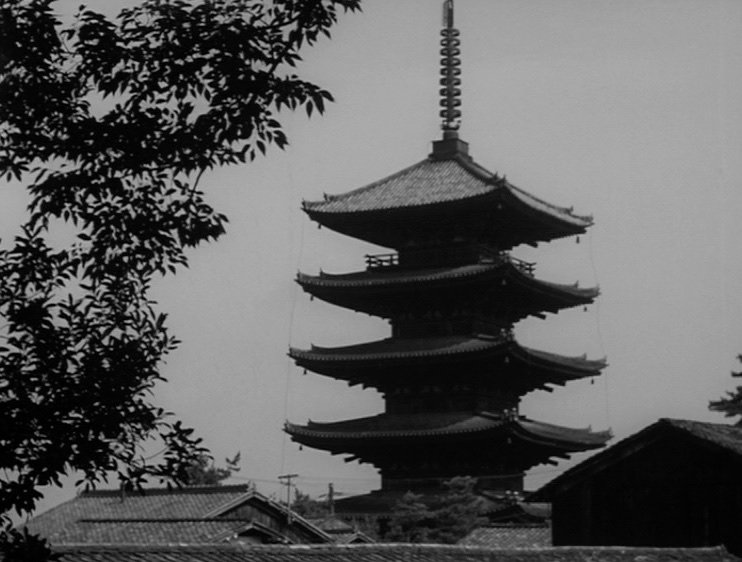 Ozu often shows the architecture of his home city, Tokyo. In a tale of a widower trying to force his reluctant adult daughter Noriko to marry and leave home, this traditional-looking building perhaps foreshadows her likely departure and destination: a symbol of 'progress'