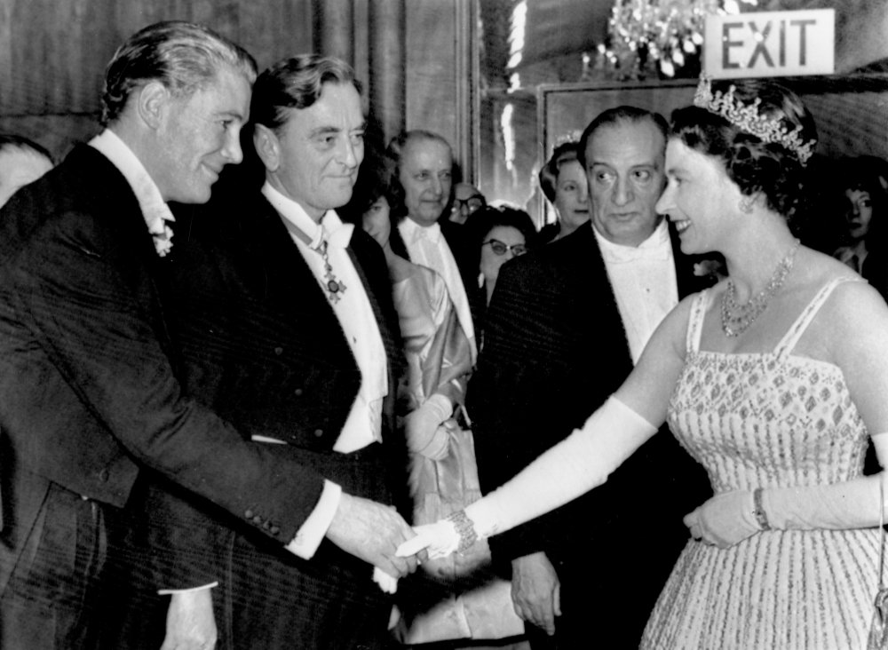 O'Toole meeting Queen Elizabeth II with director David Lean and producer Sam Spiegel at the royal premiere of Lawrence of Arabia in 1962