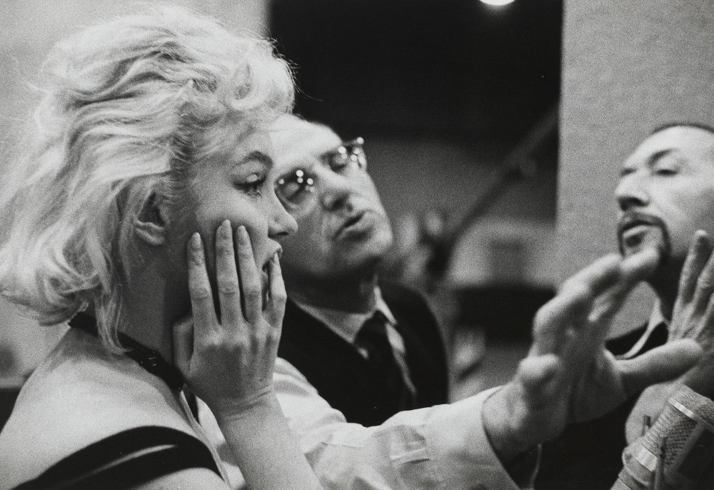 Monroe and George Cukor in production on Let's Make Love (1960)