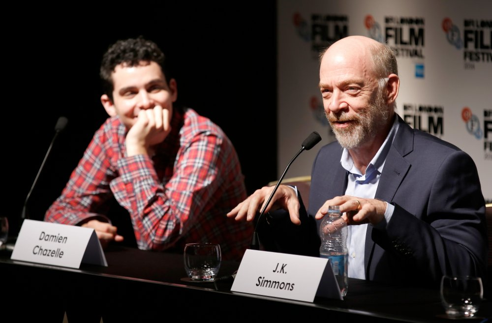 Director Damien Chazelle and actor J.K. Simmons attend the press conference for Whiplash during the 58th BFI London Film Festival