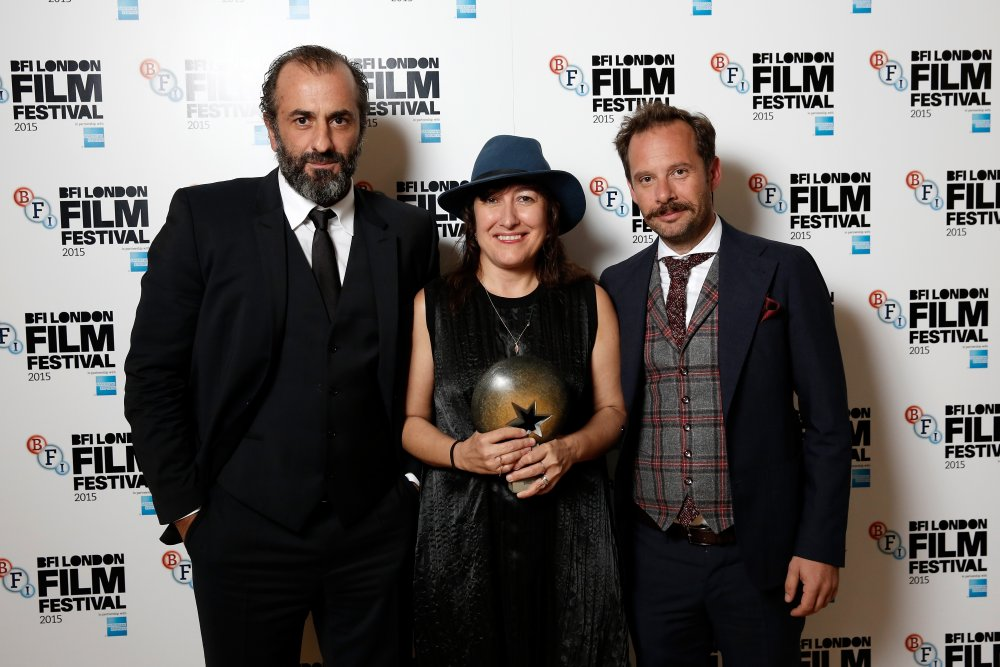 Athina Rachel Tsangari, with actors Panos Koronis and Giorgos Pyrpassopoulos, with the Best Film award for Chevalier in 2015