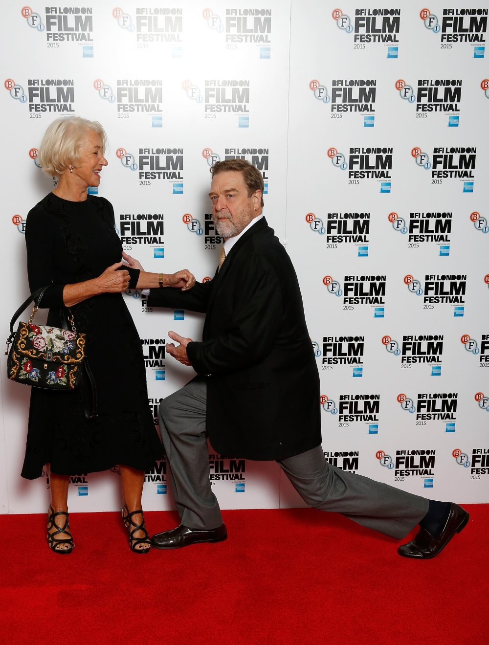 Actors Helen Mirren and John Goodman attend the Trumbo photocall during the BFI London Film Festival