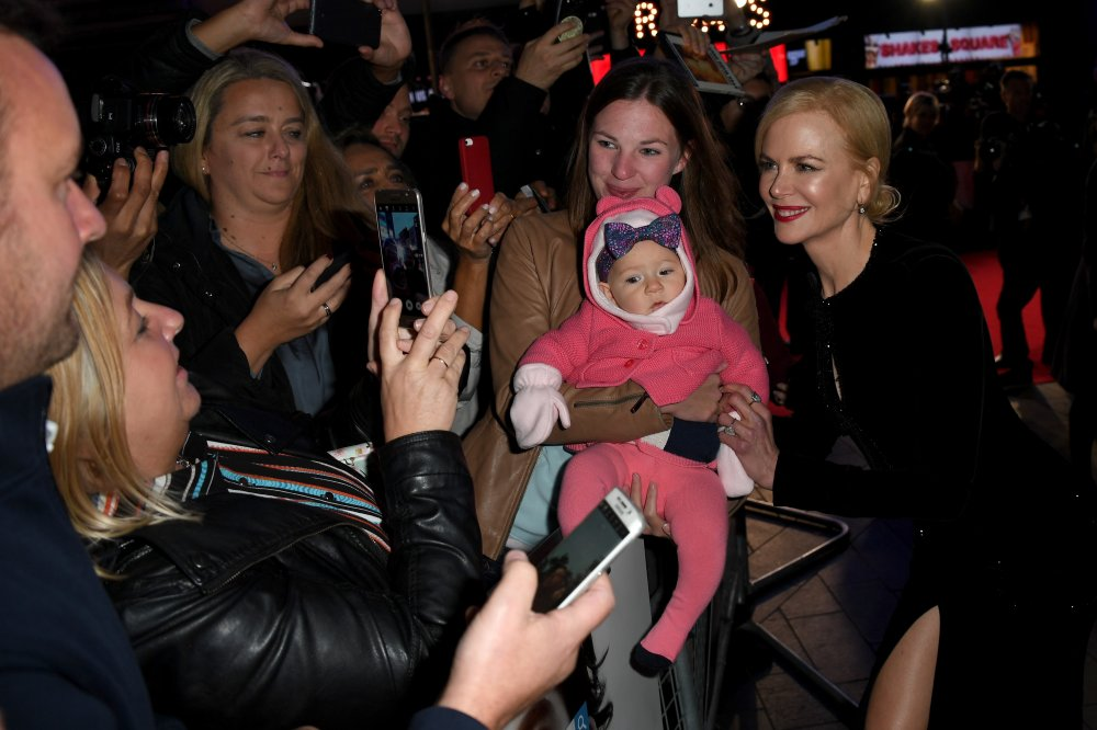 Nicole Kidman meets a young fan as she attends the Lion American Express Gala screening during the 60th BFI London Film Festival
