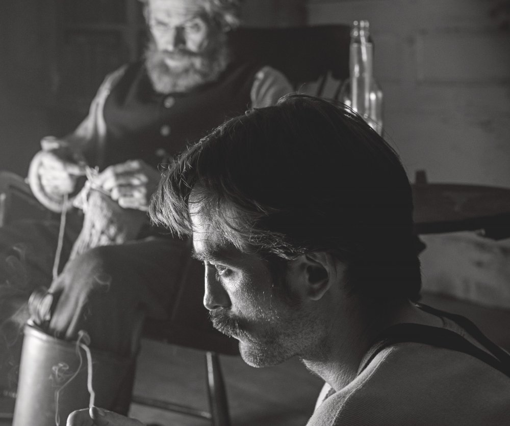 Willem Dafoe as the lighthouse-keeper and Robert Pattinson as his second in The Lighthouse