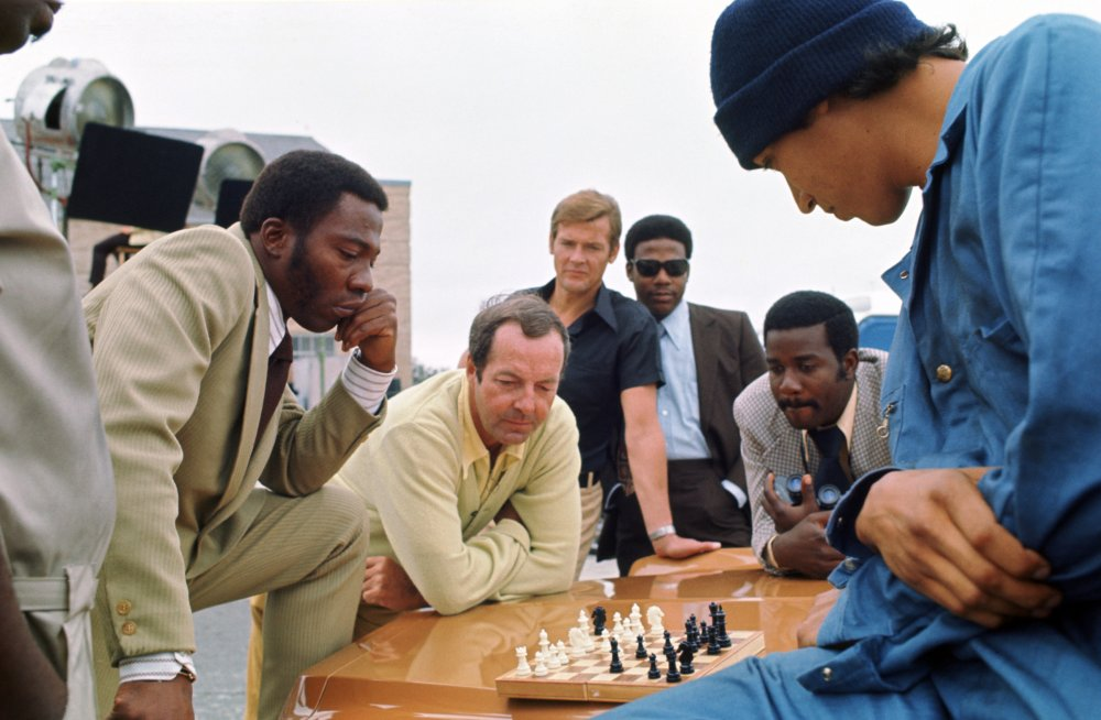 Guy Hamilton (centre) in production on Live and Let Die (1973)
