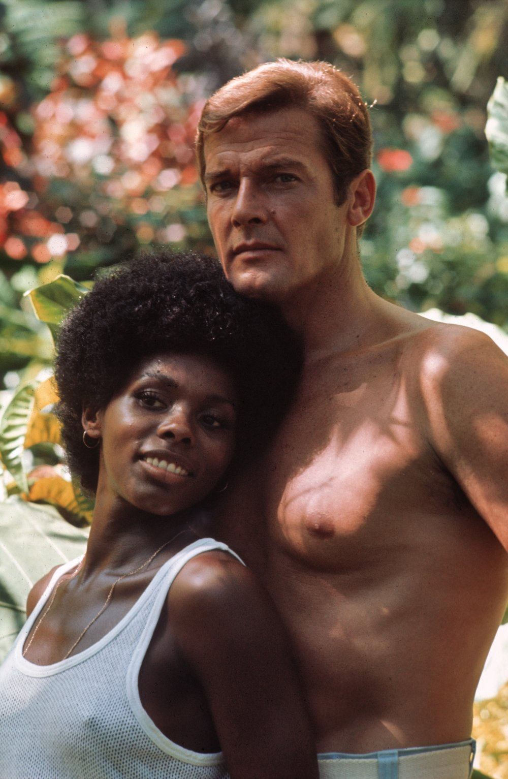 Roger Moore with Gloria Hendry in Live and Let Die (1973)
