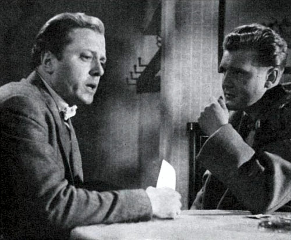 Richard Attenborough and Donald Houston in The Man Upstairs, one of the few small-scale British productions of recent years which has risked originality. The film's press was very good; its box-office returns, reportedly, were not
