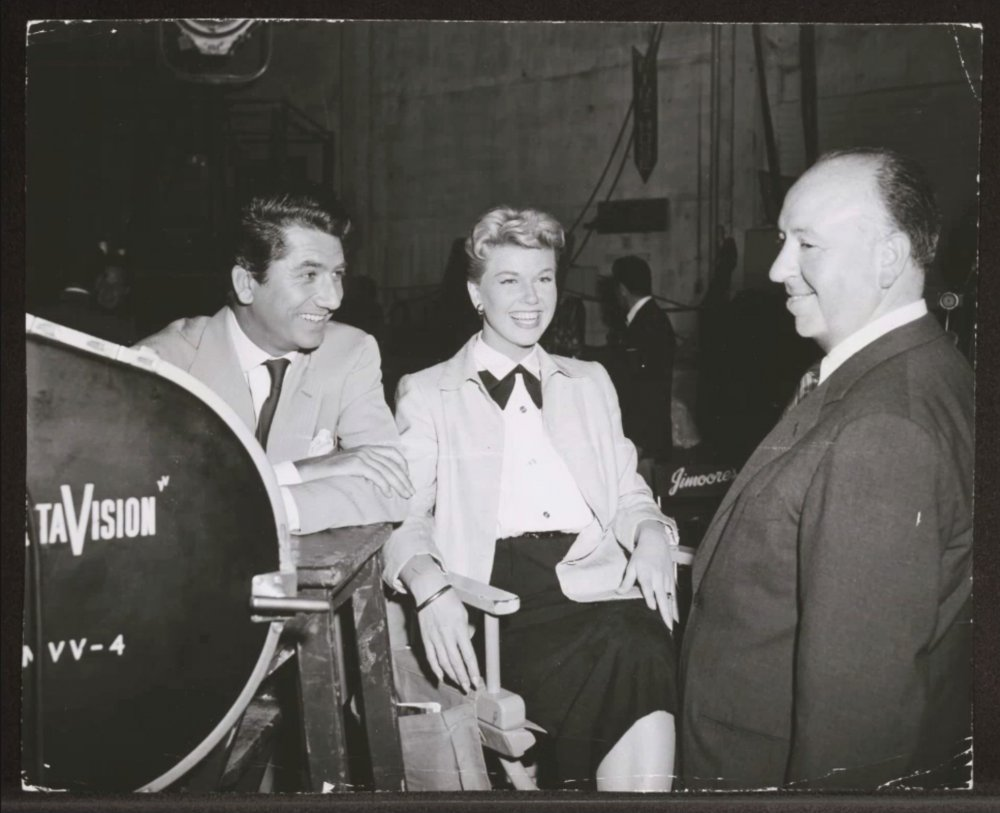 Day with Daniel Gélin (left) and Alfred Hitchcock on the set of The Man Who Knew Too Much (1956)