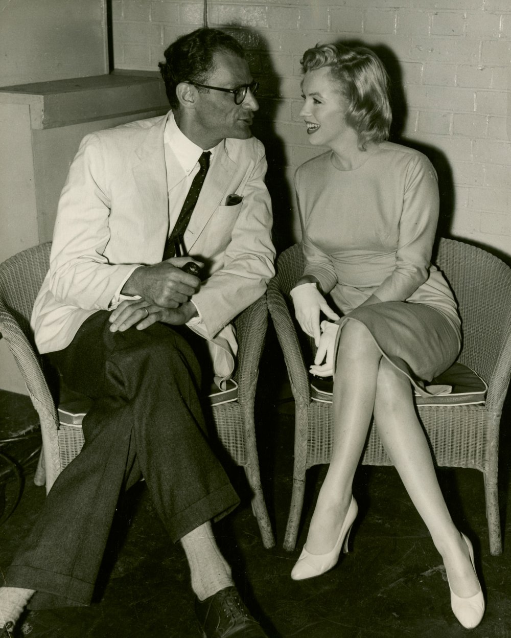 Publicity still of Arthur Miller and Marilyn Monroe at Heathrow Airport in 1956