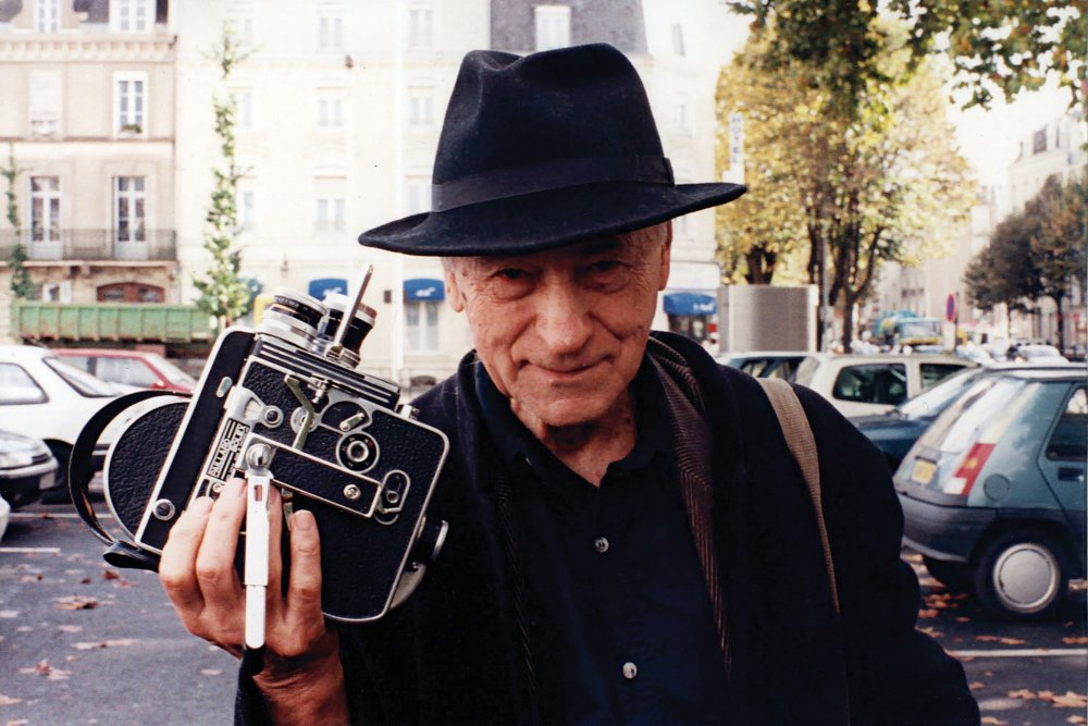 Jonas Mekas with his Bolex camera