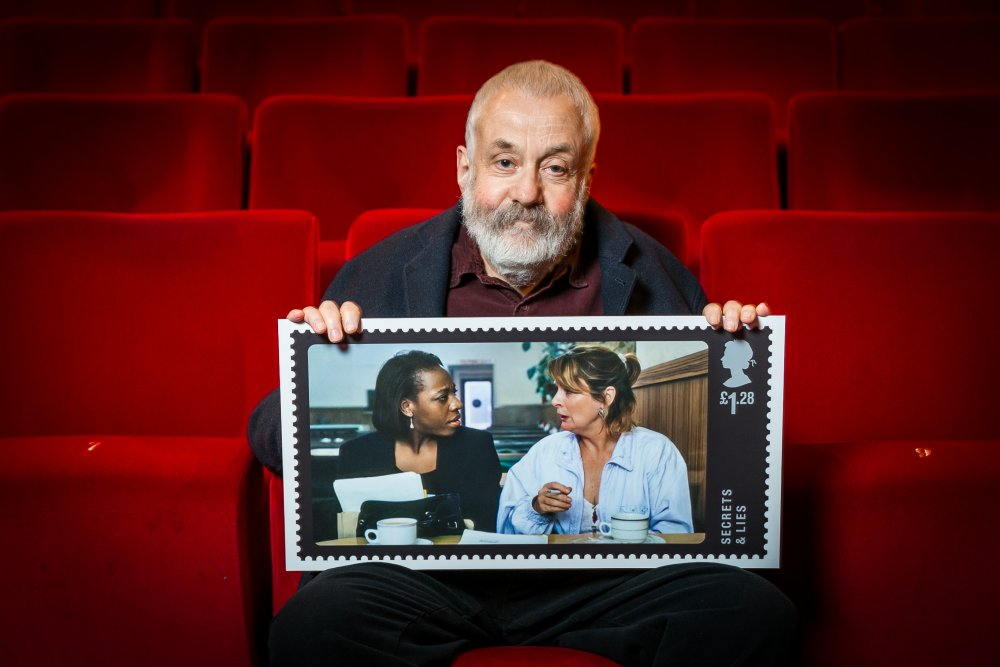 Mike Leigh displays the stamp design for Secrets and Lies.