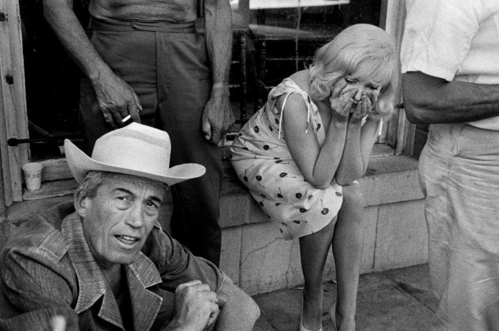 John Huston with Monroe on The Misfits (1961)