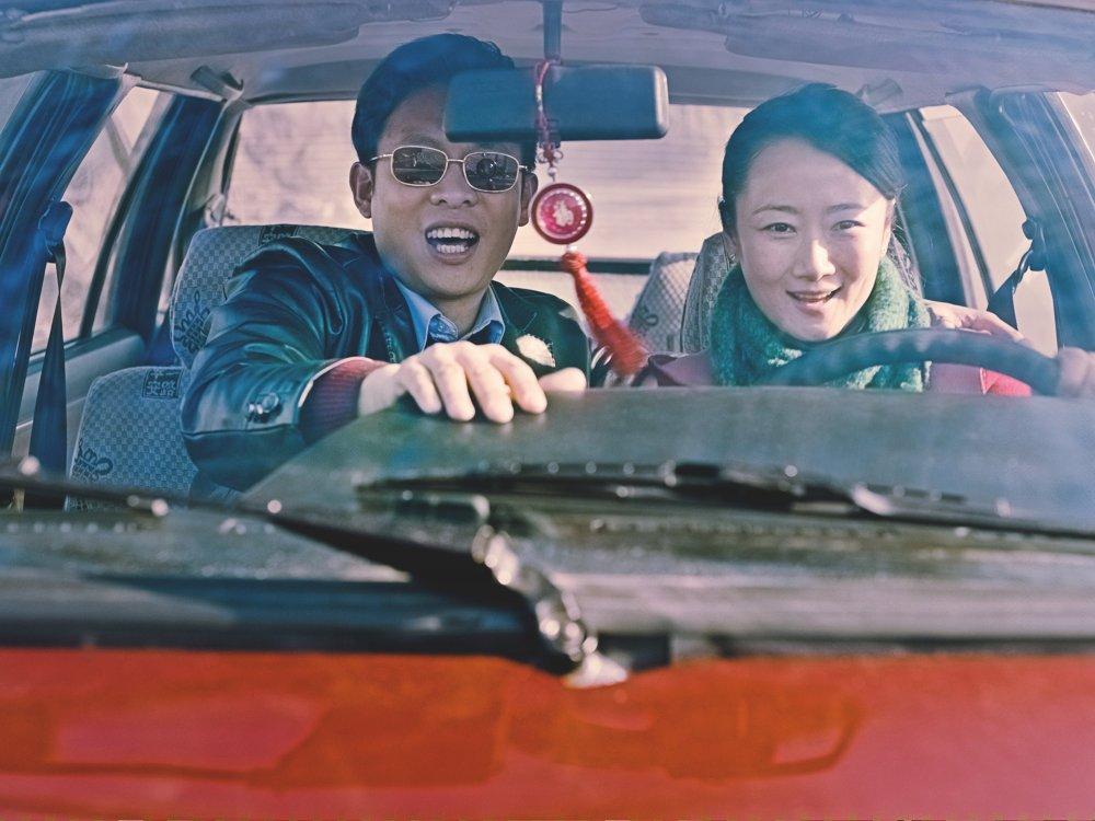 Zhang Yi as Zhang Jinsheng with Zhao Tao
