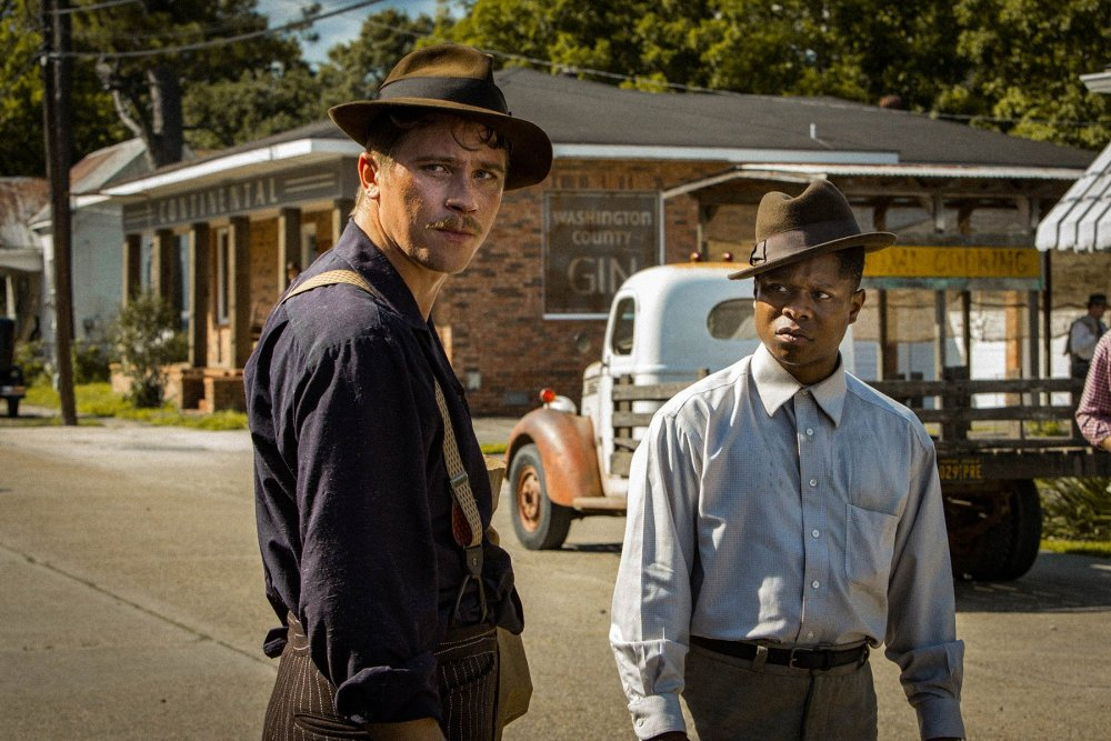 Garrett Hedlund as Jamie McAllan and Jason Mitchell as Ronsel Jackson