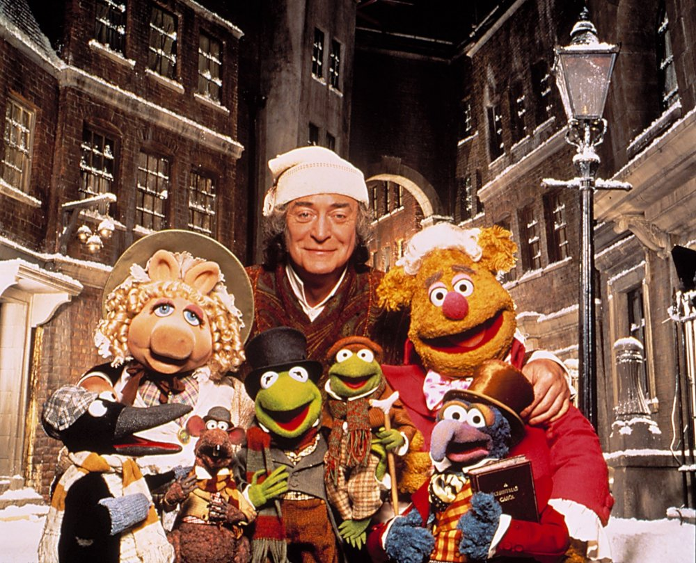 Michael Caine as Ebenezer Scrooge with his fellow cast members of A Muppet Christmas Carol (1992)