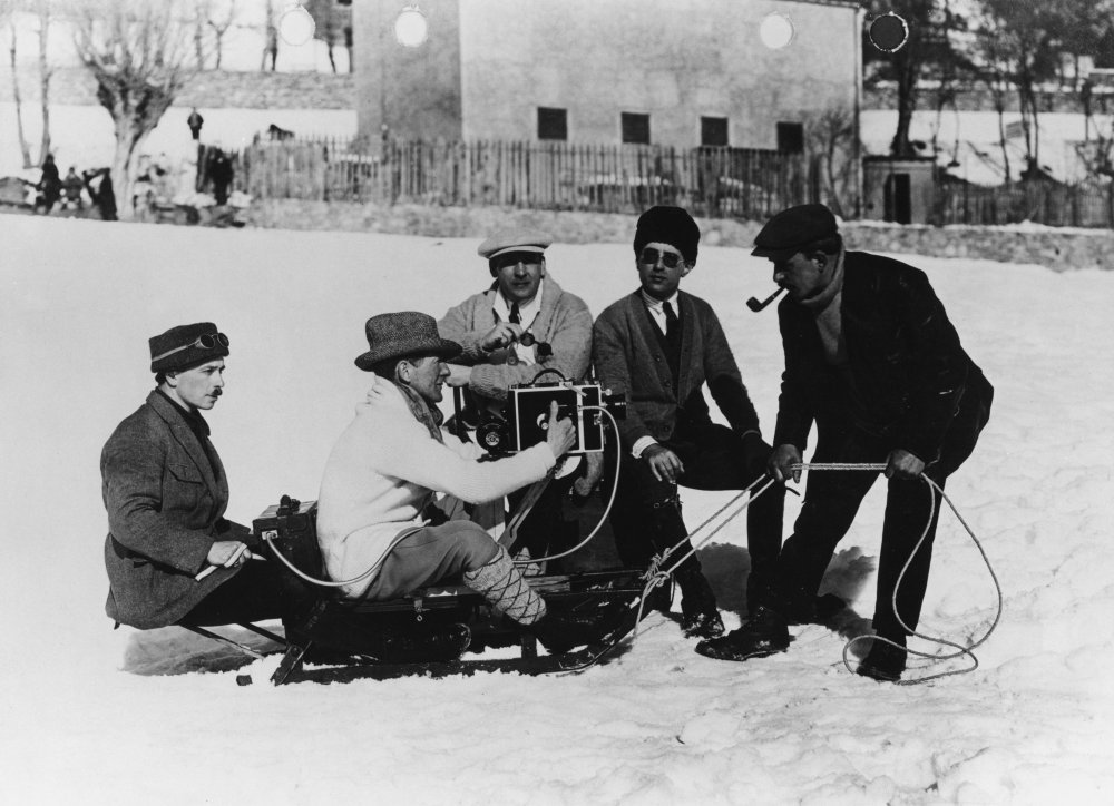 Flming the snowball fight on a toboggan