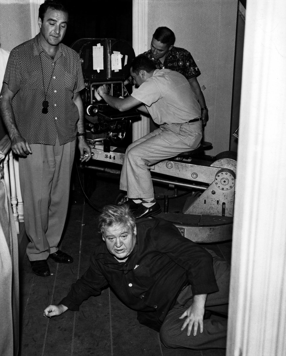 Laughton gets down to the floor to try out a shot with director of photography Stanley Cortez, also known for his work with Orson Welles. Cortez later commented: 'Apart from The Magnificent Ambersons, the most exciting experience I have had in the cinema was with Charles Laughton on Night of the Hunter.'