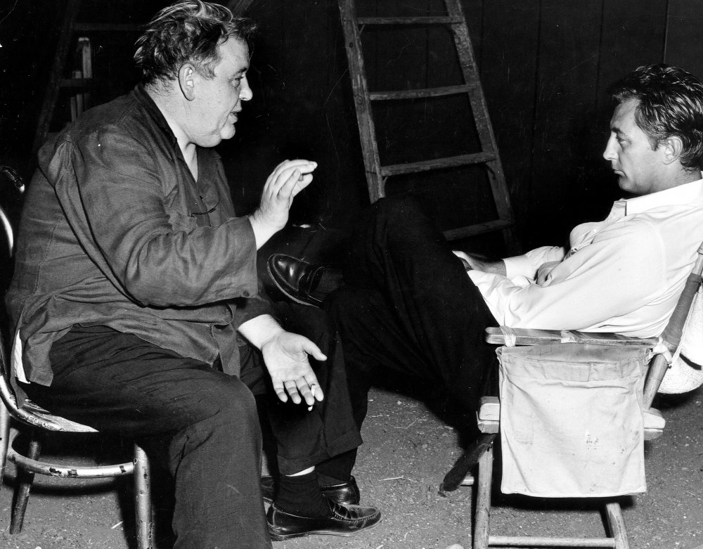 Charles Laughton chats with Robert Mitchum between takes. Although clearly a natural in the director's chair, after the critical and box-office failure of The Night of the Hunter, Laughton would never again make a film.