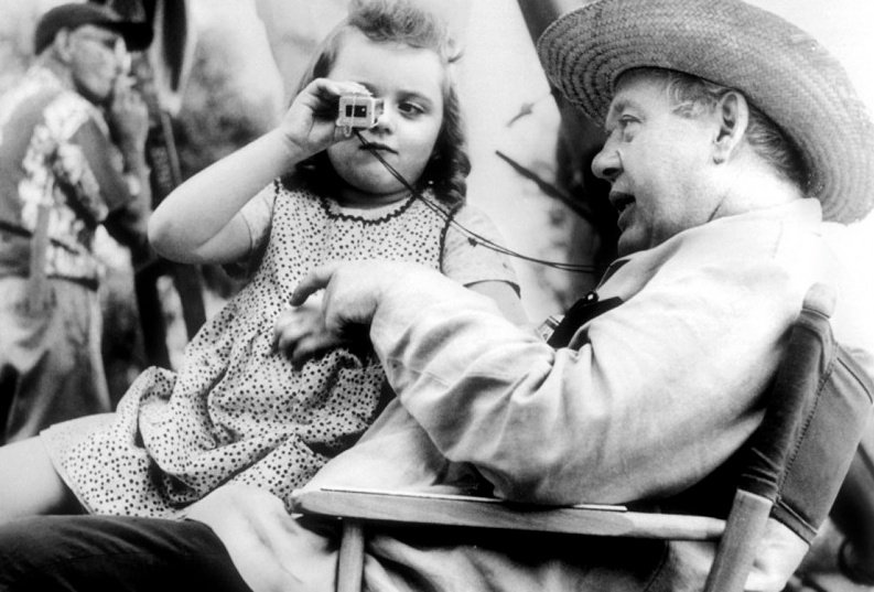 As one of the two Harper childen set in Powell's deadly sights, Sally Jane Bruce gives one of cinema's most unforgettable portrayals of a child in peril. Here she enjoys a less fraught moment, playing with a viewfinder with director Charles Laughton.