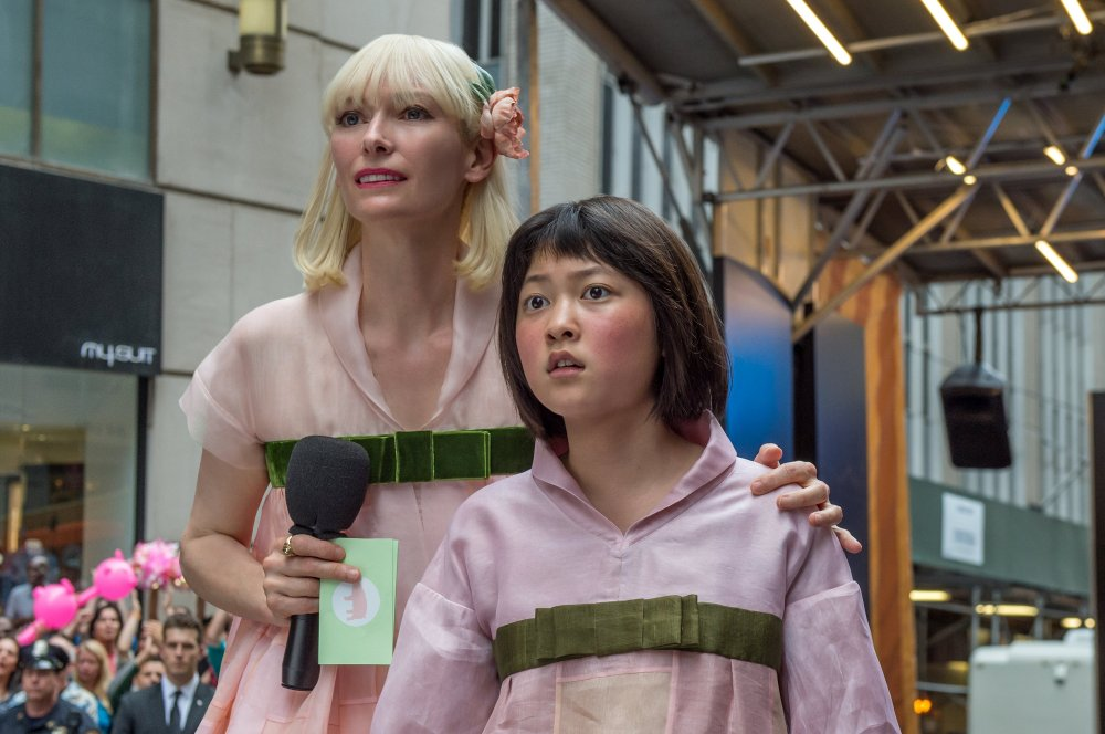 Tilda Swinton as Lucy Mirando and Ahn Seo-Hyun as Mija in Bong Joon-ho's Okja
