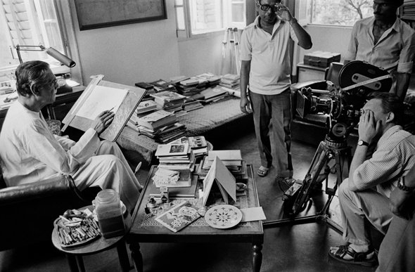 Ray in his study at Bishop Leroy, Calcutta, 1988. This photograph was taken during the production of Omnibus: The Cinema of Satyajit Ray, a BBC documentary on Ray. The gentleman behind the camera is Adam Low, director of the feature