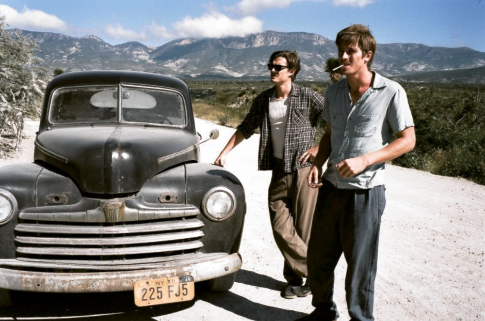 Garrett Hedlund as Dean Moriarty, front, with Sam Riley as Sal Paradise