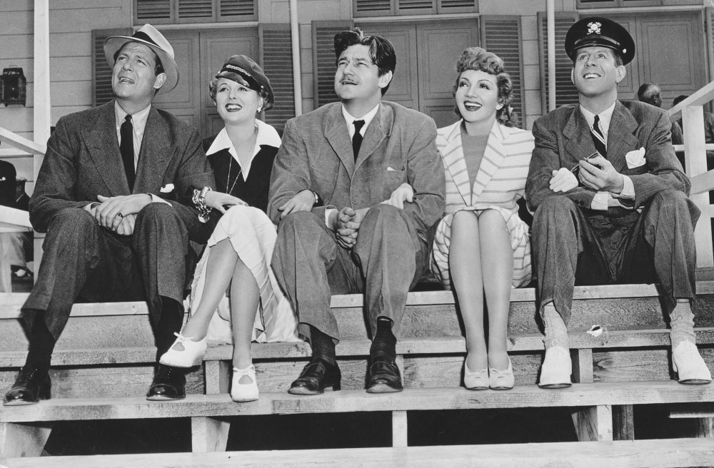 Preston Sturges (centre) with cast members Joel McCrea, Mary Astor, Claudette Colbert and Rudy Vallée on the set of The Palm Beach Story (1942)