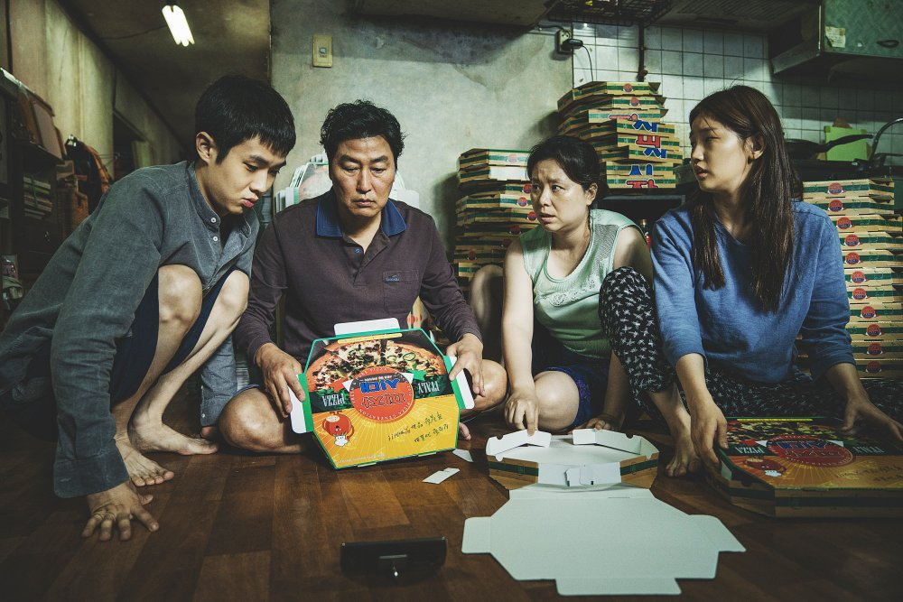 Choi Woo-shik as Ki-woo, Song Kang-ho as Ki-taek, Chang Hyae-jin as Chung-sook and Park So-dam as Ki-Jung in Parasite (Gisaengchung)
