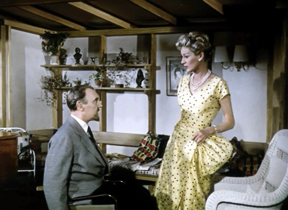 Ralph Richardson and Margaret Leighton in The Passionate Stranger (1957)