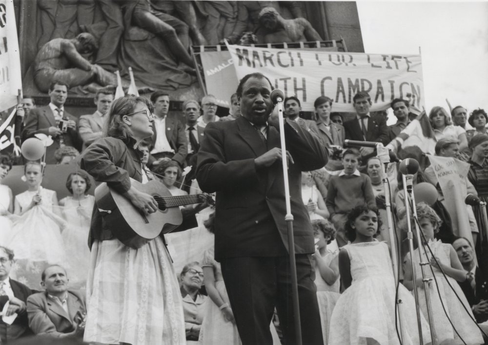 American actor Paul Robeson at an anti-nuclear march organised by the British Peace Committee on 29 June 1959. The march progressed from Marble Arch to Trafalgar Square, where Robeson sang 'Ol' Man River' to a crowd of 10,000