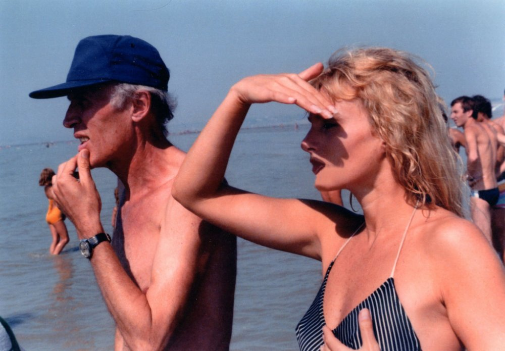 Eric Rohmer filming Pauline at the Beach (1983) with actor Arielle Dombasle