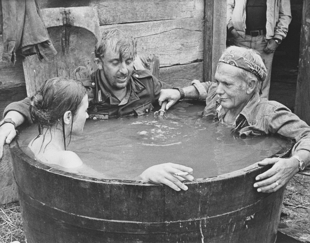 Sam Peckinpah and cast members on the set of Cross of Iron (1977)