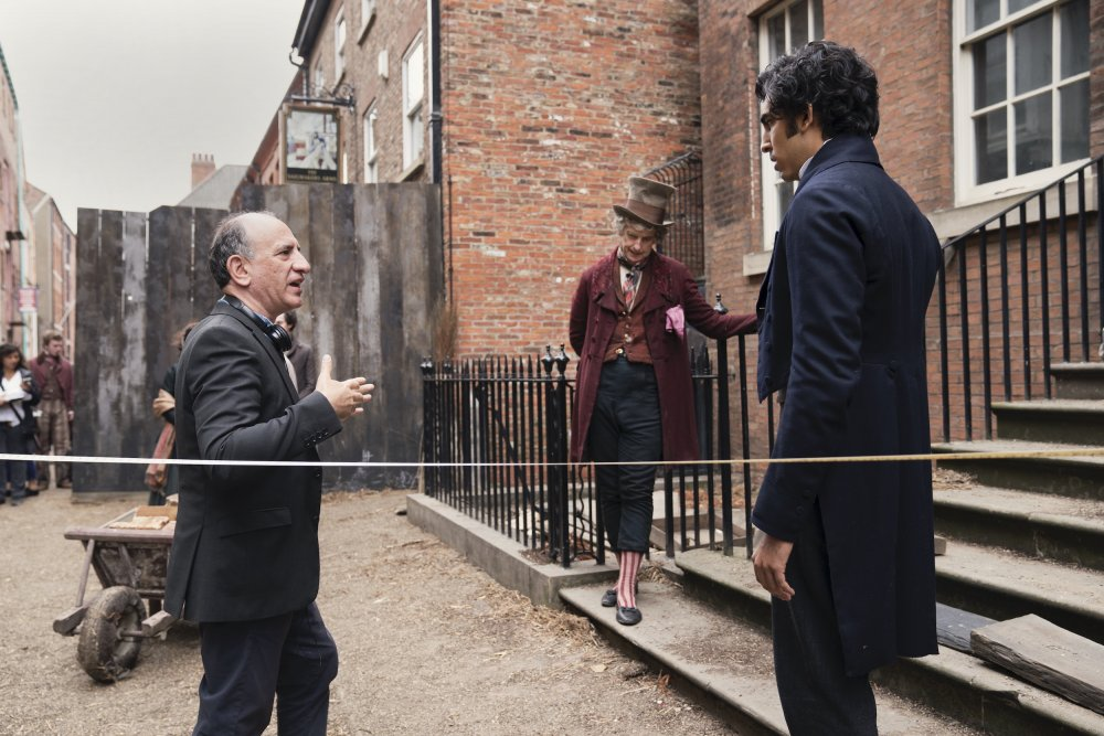 Iannucci directing Peter Capaldi (as Mr Micawber) and Patel