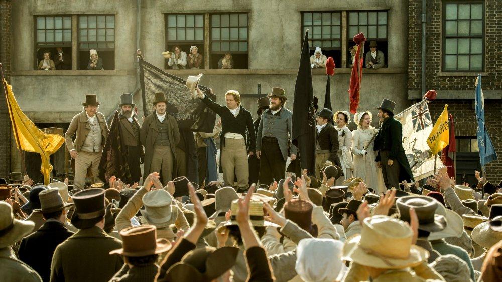 Rory Kinnear (waving hat) orates as Henry Hunt in Peterloo