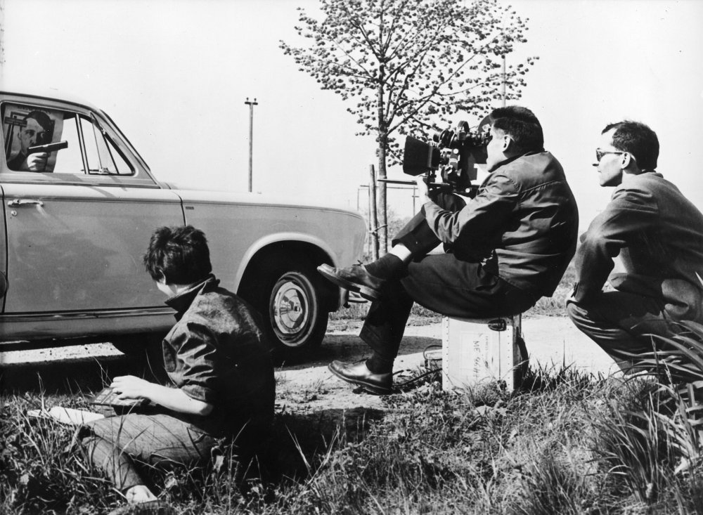 Godard and Raoul Coutard shoot a roadside scene for Le Petit Soldat, an Algerian war espionage drama. Though this was Godard's second film, shot in 1960, it was banned by the French authorities because of its political content and not released until 1963