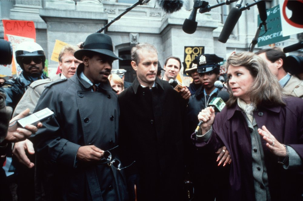 Denzel Washington and Tom Hanks meet the press outside the courtroom in which in Jonathan Demme's Philadelphia (1993)