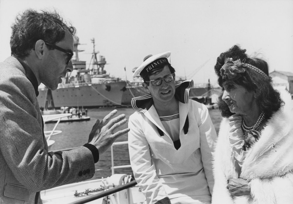 Godard on the quayside in Toulon with Princess Aïcha Abadie, during filming of her short cameo appearance in the latter part of Pierrot le fou