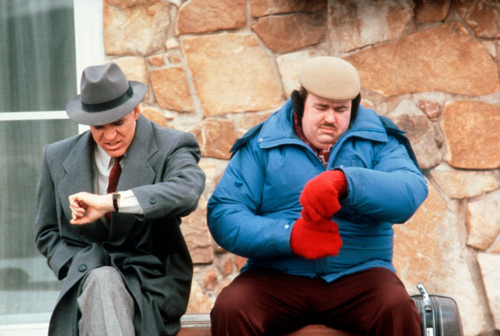 Compare and contrast two approaches to winter style in Planes, Trains and Automobiles (1987): Steve Martin's marketing executive clearly struggling to stay warm in grey suit and overcoat, while John Candy's brash curtain-ring salesman leaves nothing to chance in beret, ear muffs, bold red gloves and thickly-padded ski jacket