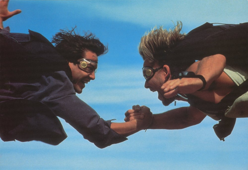 'Little hand says it's time to rock 'n' roll': Keanu Reeves and Patrick Swayze take a stand in Kathryn Bigelow's Point Break (1991)