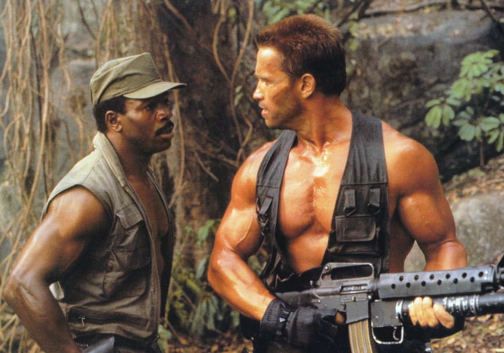 Carl Weathers as CIA agent Dillon with Schwarzenegger