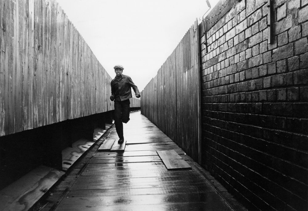Caught up in a crime he did not commit, Anthony 'Tony' Watson (Herbert Norville) runs for his life as he is pursued by the Metropolitan Police. This image was also used for the Pressure poster
