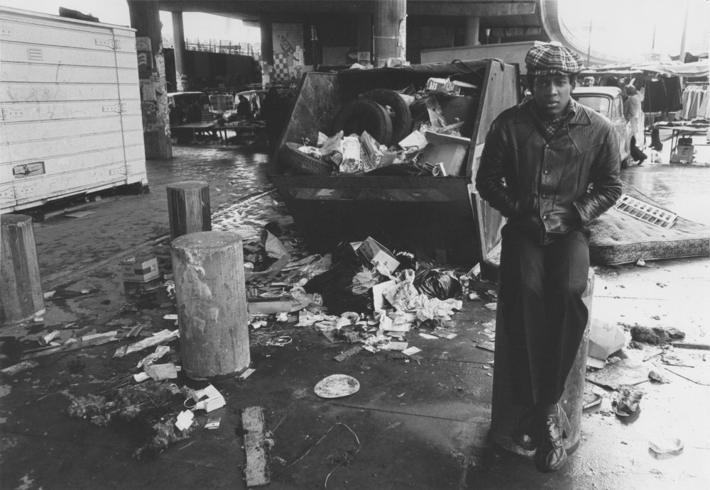 Herbert Norville as Tony. Ové was also a photographer who previously documented the Black Power struggle in the UK. This photo of Tony at a Portobello Market depicts him struggling with life on the streets, alienated from opportunities his white friends take for granted