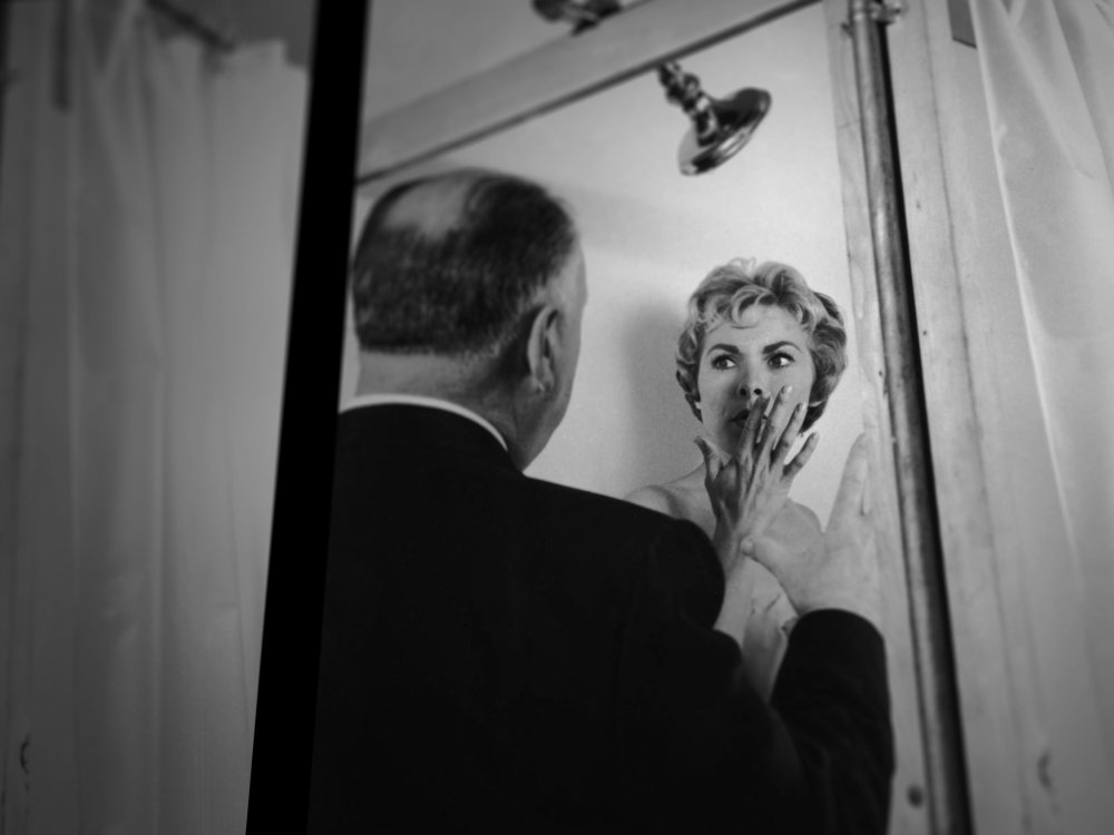 Hitchcock and Janet Leigh filming the shower scene