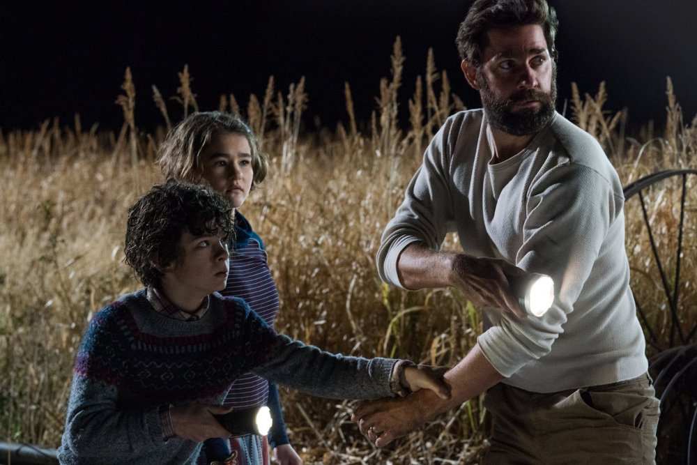 Noah Jupe as Marcus Abbott, Millicent Simmonds as Regan and director John Krasinski as Lee in A Quiet Place