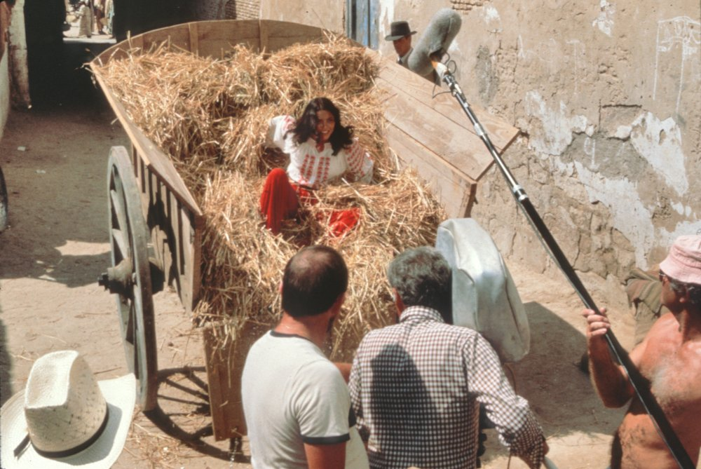 Karen Allen gets an unexpected ride in the back of a hay cart during a chase through the streets of Cairo
